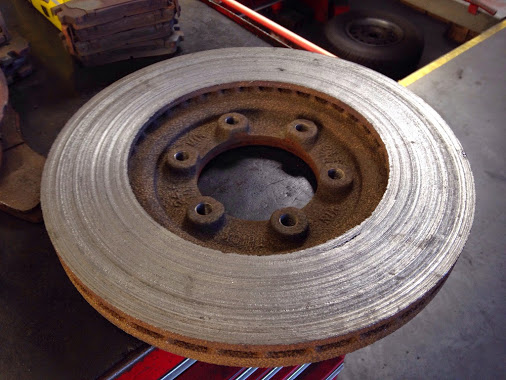 worn disc rotor being replaced at buckleys auto care wilmington delaware